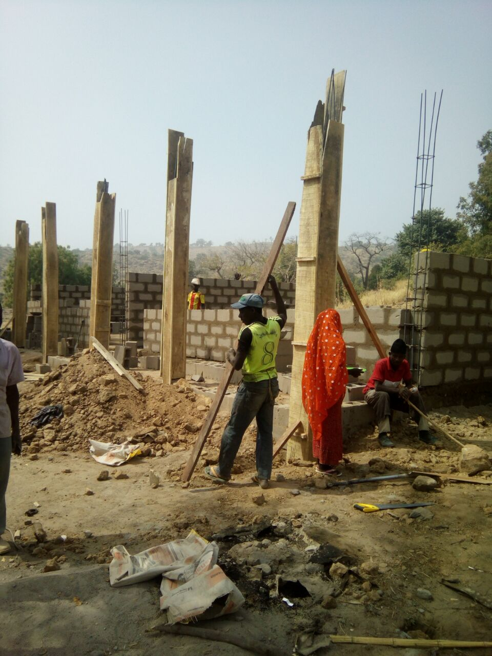 construction of a block of two classroom offices and a store